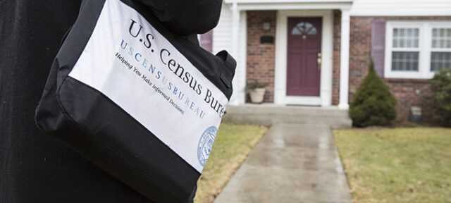 Census taker at door to a home