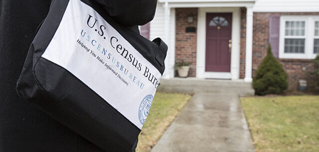 photo = Census Field Worker Approaching House