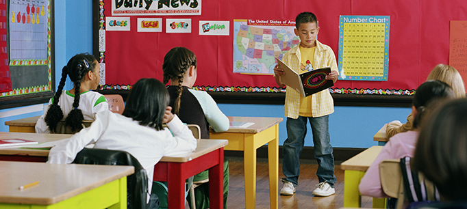 photo - Elementary School Student Giving a Presentation