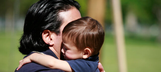 photo - Father and Son Hugging