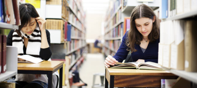 Two Students Working In A Library