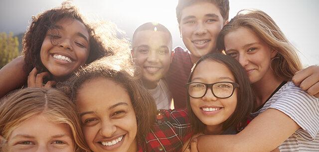 Teenage School Friends Smiling To Camera