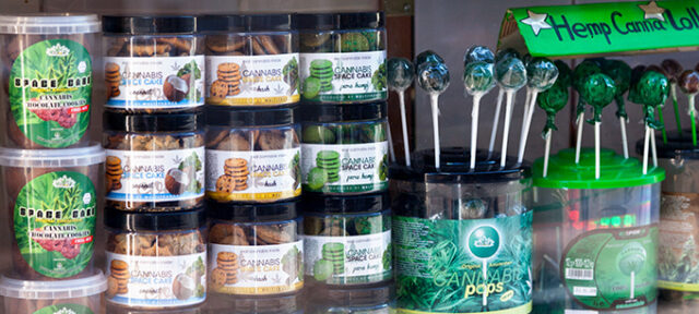 Amsterdam, Netherlands - August 27 2017: Variety of cannabis related products in a display case of a coffee shop in Amsterdam.