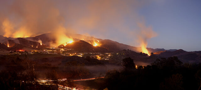 A collection of fires burning across the hillside near homes In Portola Hills, California.