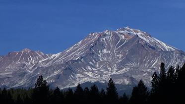 Photo of mountain with minimal snow