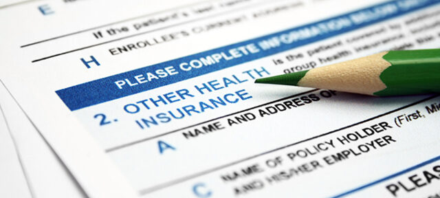 Health Insurance Form With Lead Pencil Resting On It
