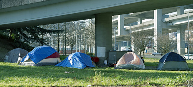 Homeless Encampment Below Freeway In Seattle WA
