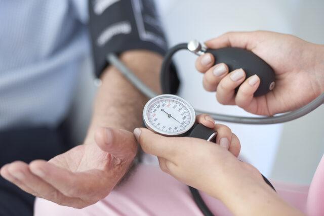 photo - nurse measuring blood pressure