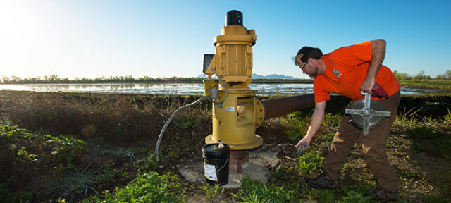 Glen Gordon, engineering geologist with the California Department of Water Resources, measures the water depth at specific agricultural wells in Colusa County on March 17, 2016.  Measuring and recording takes place a couple times a year throughout the state at multiple locations to help develop databases for groundwater levels, and report hydrologic data and historic groundwater levels.  Kelly M. Grow / California Department of Water Resources, FOR EDITORIAL USE ONLY