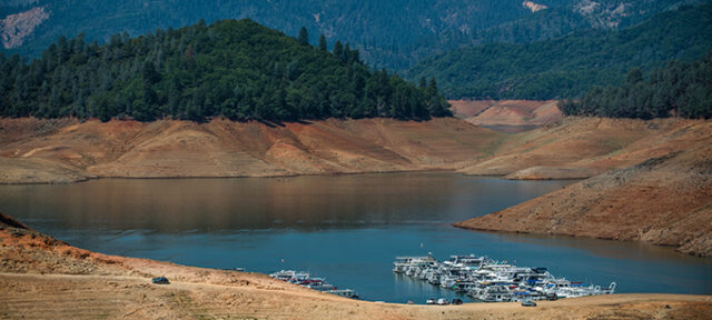 Photo of Shasta Lake with low water during drought
