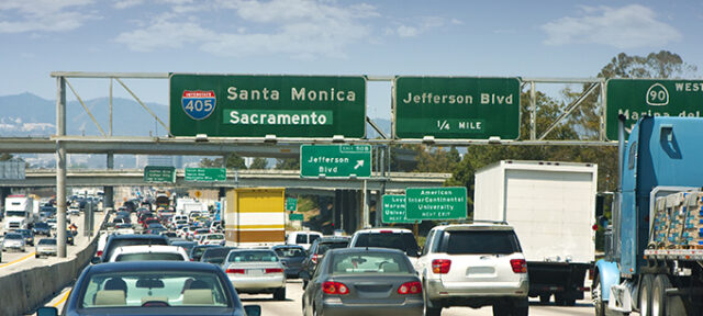Traffic And Street Signs On An LA Freeway
