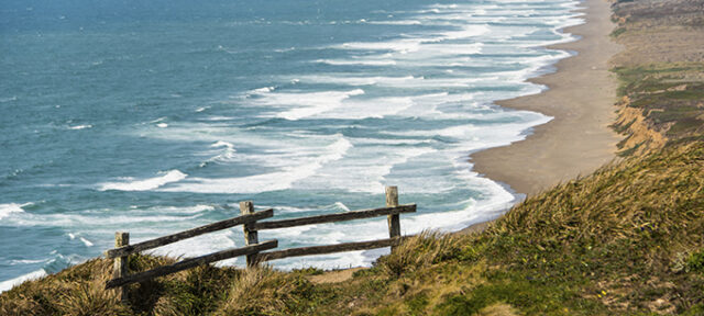 Wooden Fence On A Cliff By The Pacific Ocean