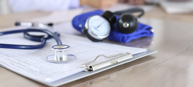 Medical Stethoscope Lying On Cardiogram Chart Closeup