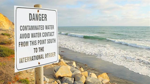 Photo of water contamination sign at beach