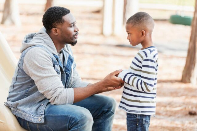photo - African American man with his son