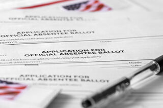 photo - Application for Absentee Ballot, Pen, and Stamps