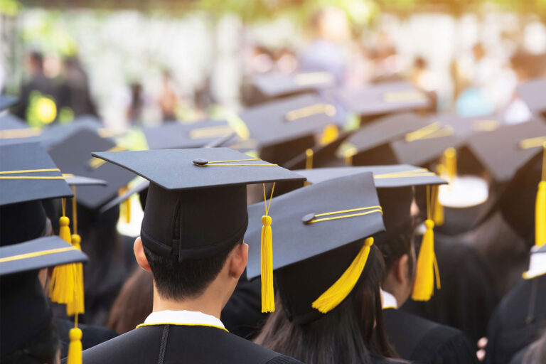 photo - Back of Graduates Wearing Mortar Boards