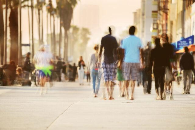 photo - Blurred Pedestrians Walking on Venice Beach Boardwalk