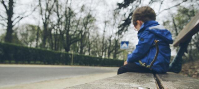 Boy Alone On Bench