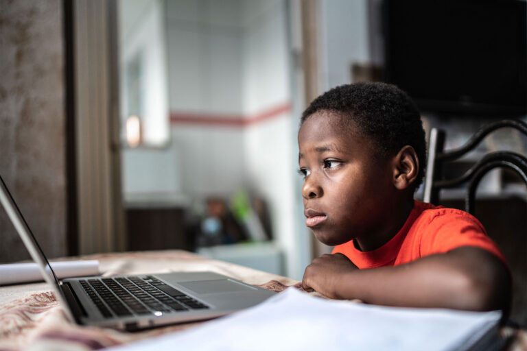 photo - A Boy Distance Learning and Using Laptop