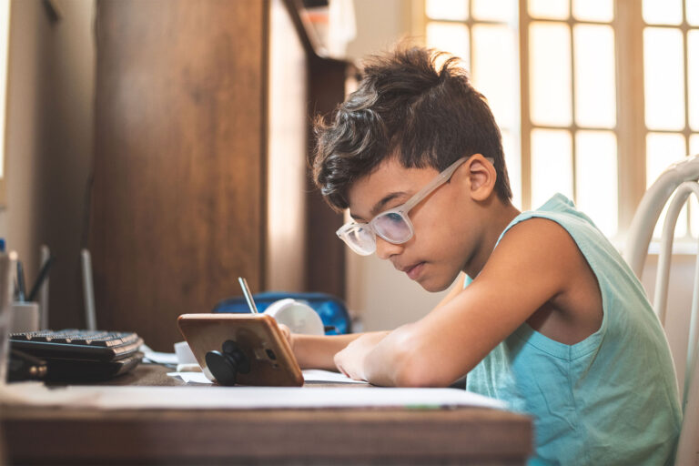 photo - Boy Using Mobile Phone for Online Learning from Home