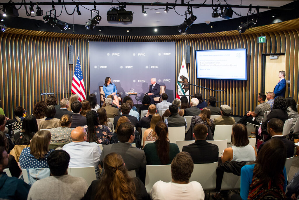 Photo of London Breed, Mark Baldassare, and the audience