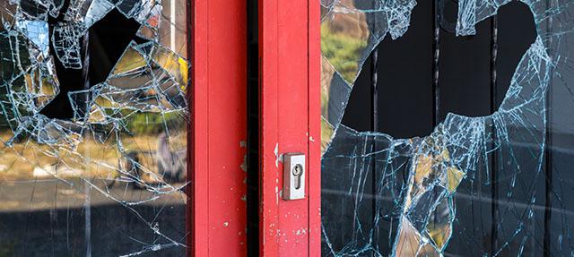 photo - Broken Window at Business