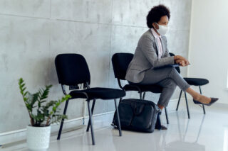 photo - Woman Wearing Mask and Waiting for a Job Interview