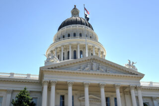 photo - Capitol Building in Sacramento, California with Flags Flying