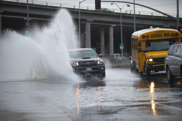 photo - Car Driving thru Flood