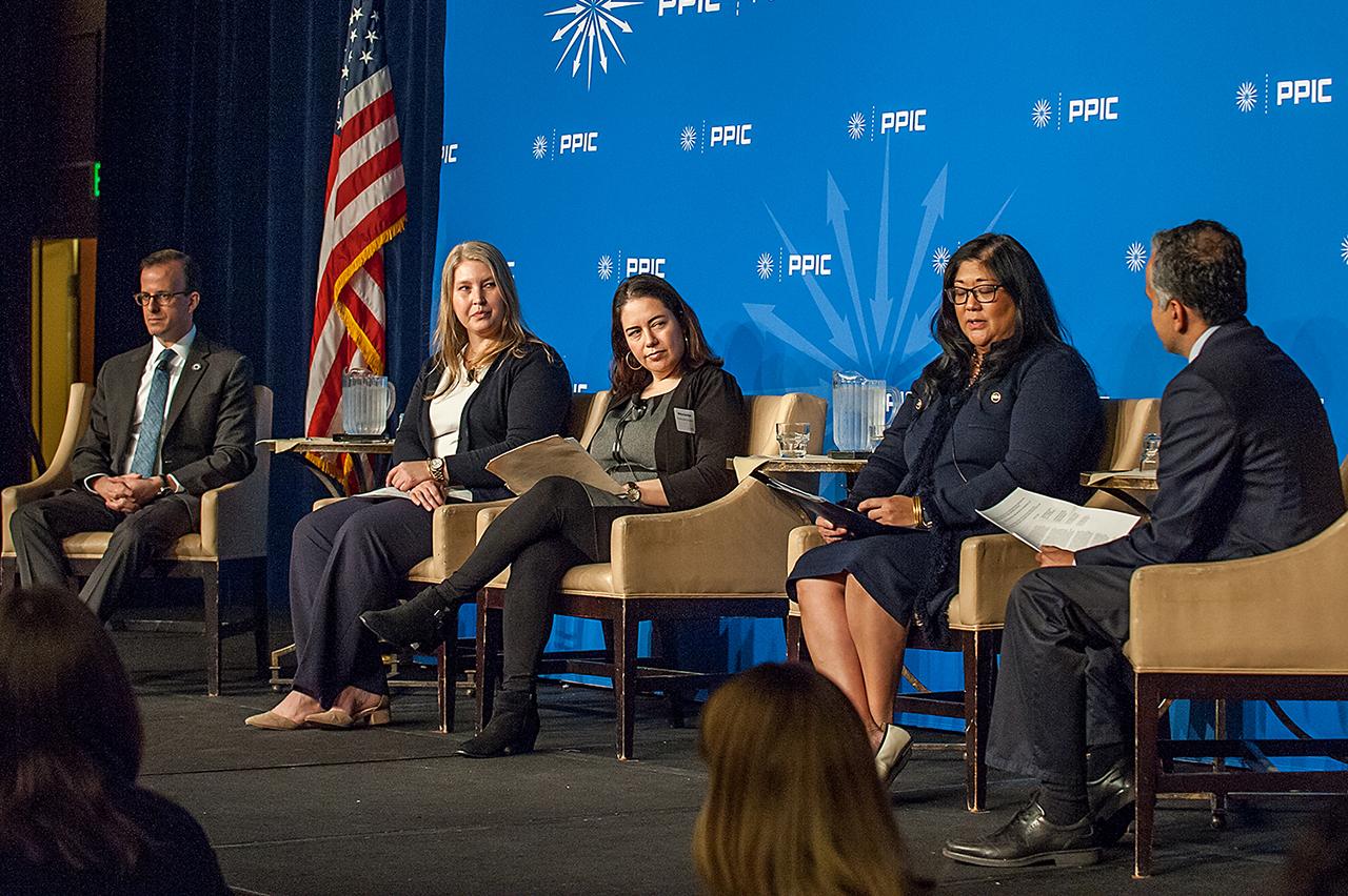 Photo of panelists on stage