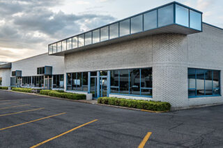 photo - Closed Small Business with Empty Parking Lot