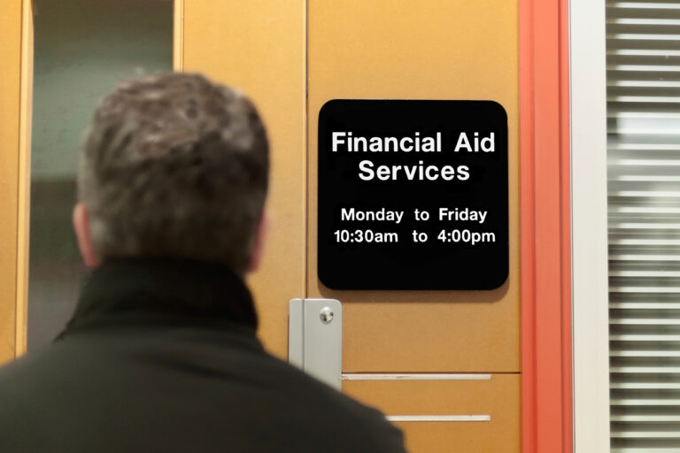 photo - man walking into a financial aid office