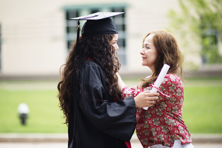 photo - College Graduate Hugging Her Mother