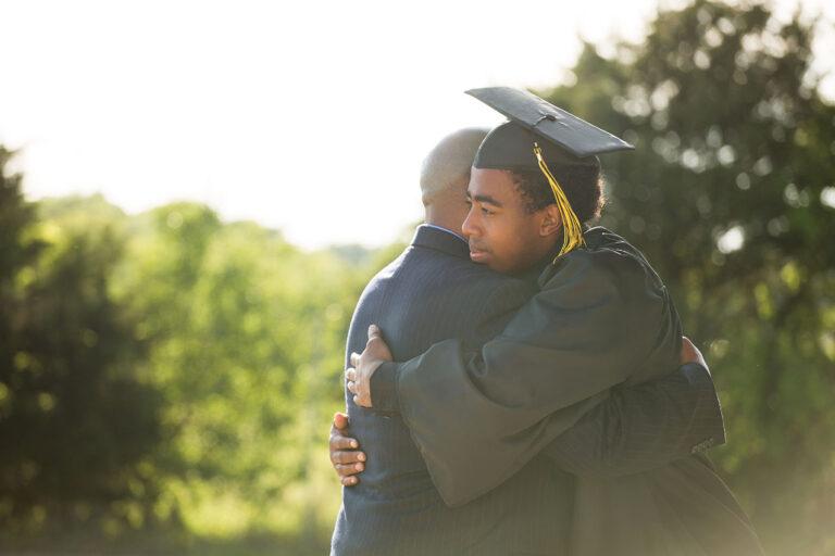 photo - College Graduate Hugging His Father
