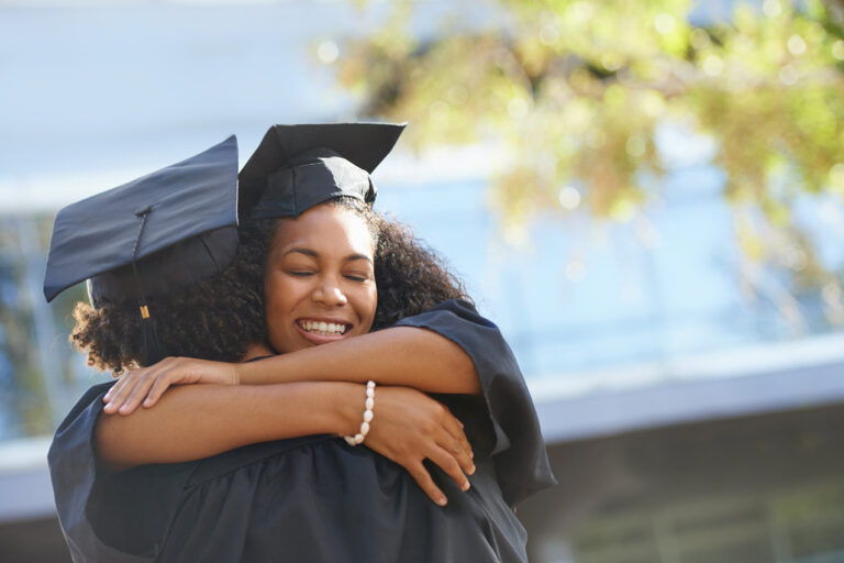 photo - college graduates hugging