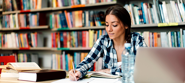 Photo of college student in the library