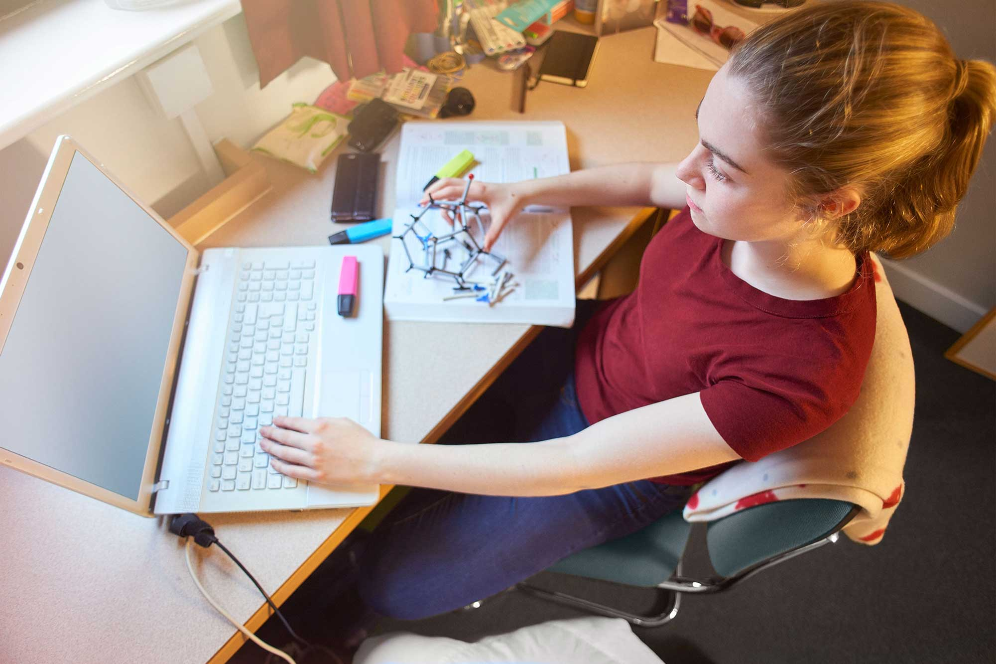 photo - College Student Online Learning from Dorm Room