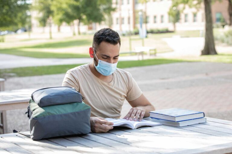 photo - College Student Studying Outdoors