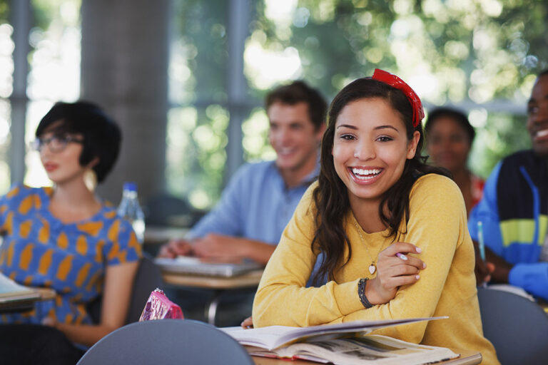 photo - College Students Smiling in Classroom
