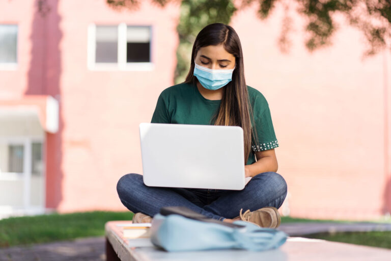 photo - College Student Studying Outside on Campus