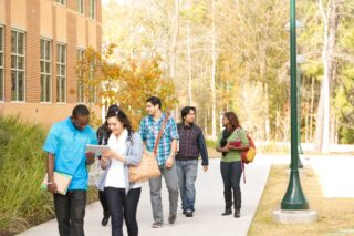 photo - College Students Talking and Walking on Campus
