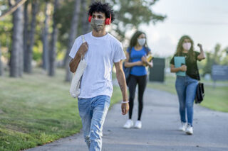 photo - College Students Wearing Masks and Walking on Campus