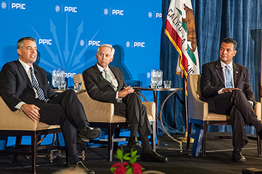 Mark Baldassare, PPIC president and CEO, talks to secretary state candidates Alex Padilla and Pete Peterson.