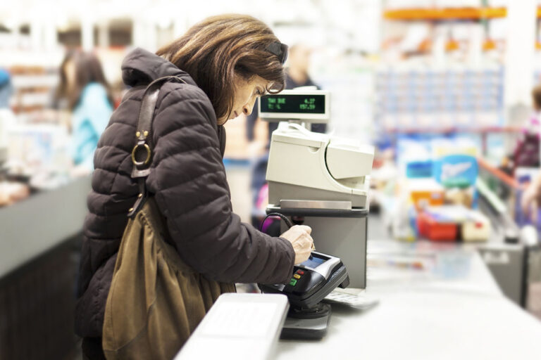 photo - Customer at Grocery Store Checkout