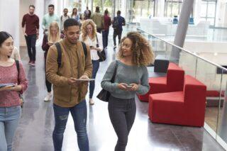 photo- Diverse Students Walking and Talking