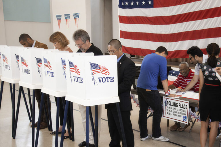 photo - people voting in polling place