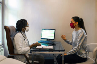 photo - Doctor Listening to Patient