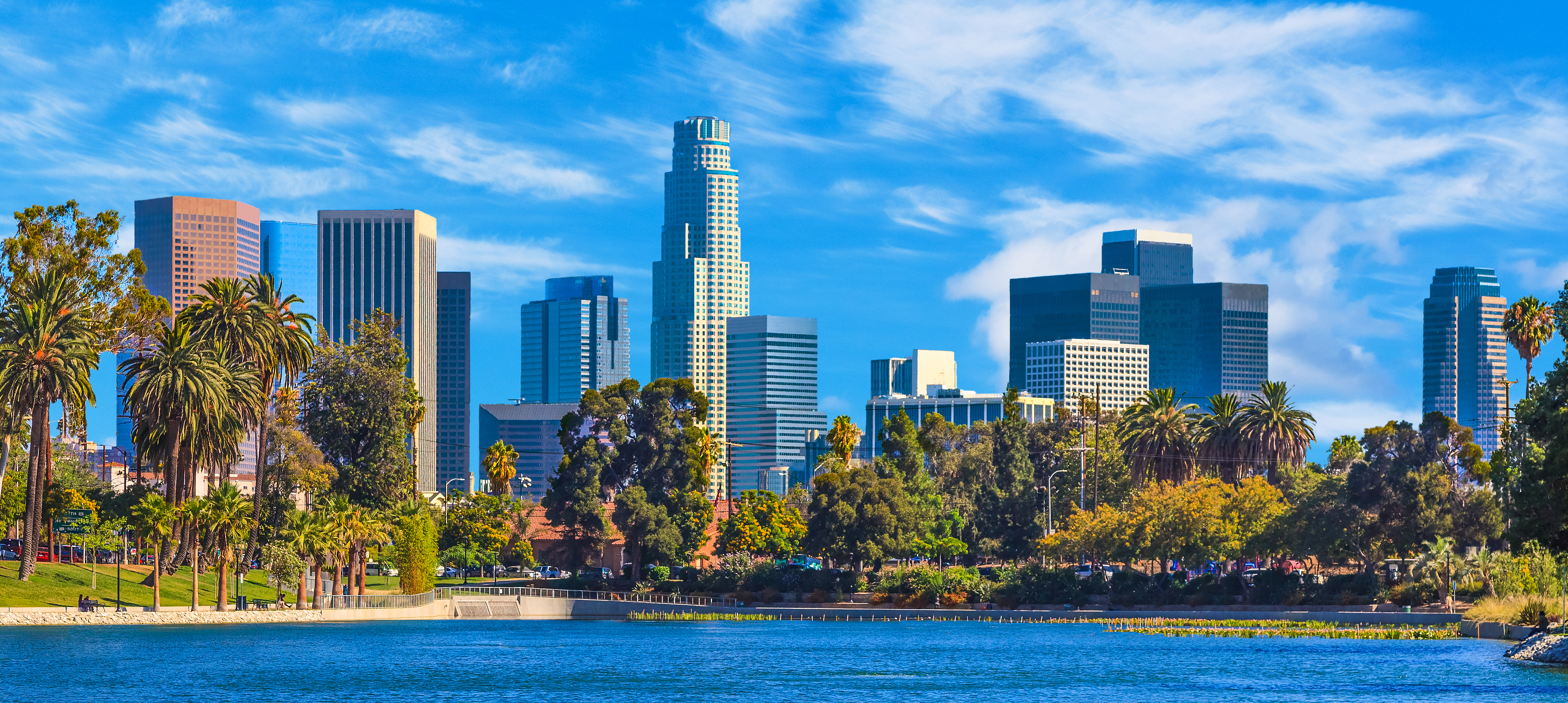 Summer day with the skyline of Los Angeles with water patterns of lake in forground, California