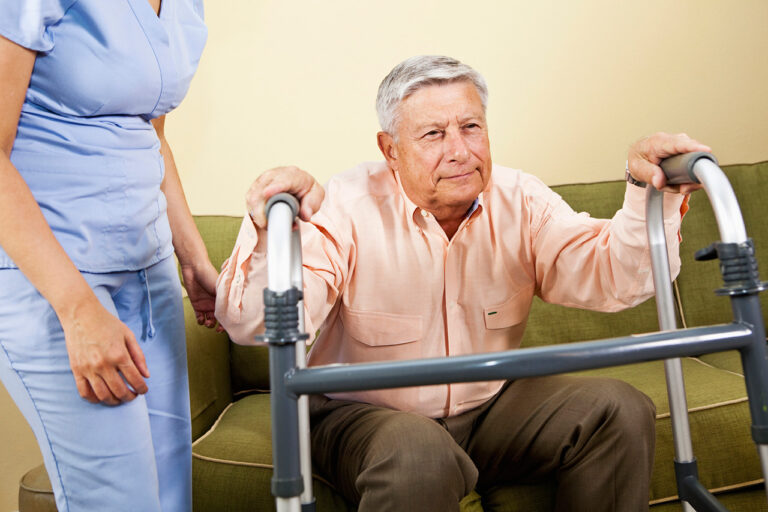 Photo of an elderly man with caregiver